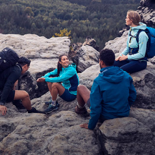 Hiking group sitting on rocks